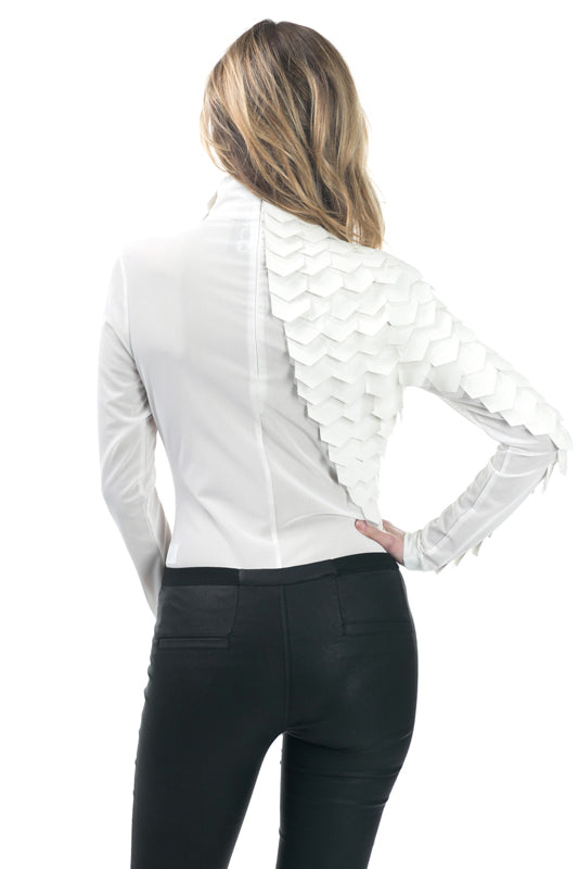 Back view young woman wearing off white long sleeve mesh bodysuit with pleather scales