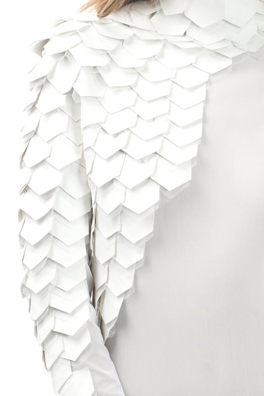 Detail view off white long sleeve mesh bodysuit with pleather scales