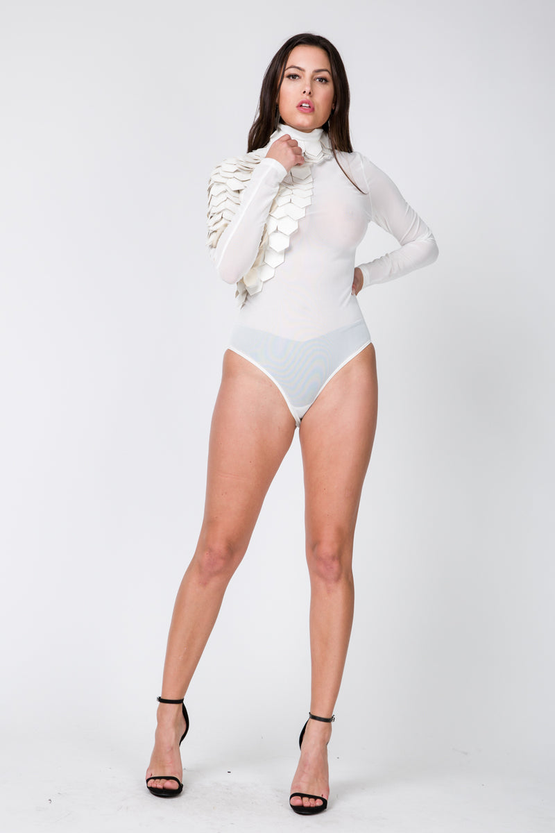 Full front view young woman wearing off white long sleeve mesh bodysuit with pleather scales