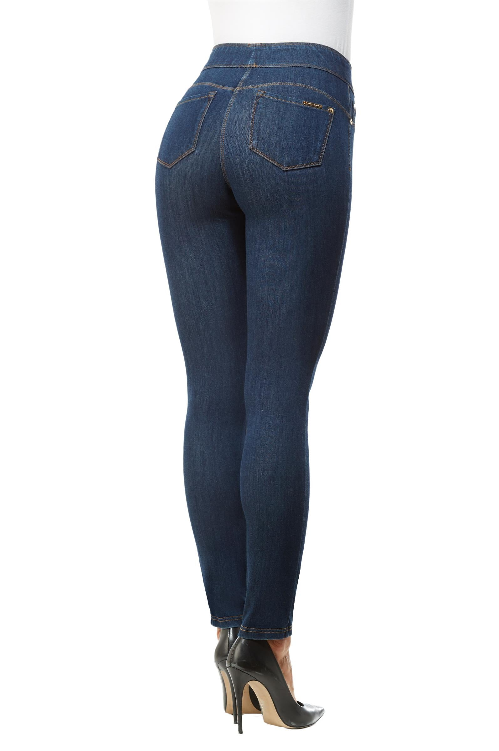 Back view woman wearing dark indigo wash jeggings with high heels