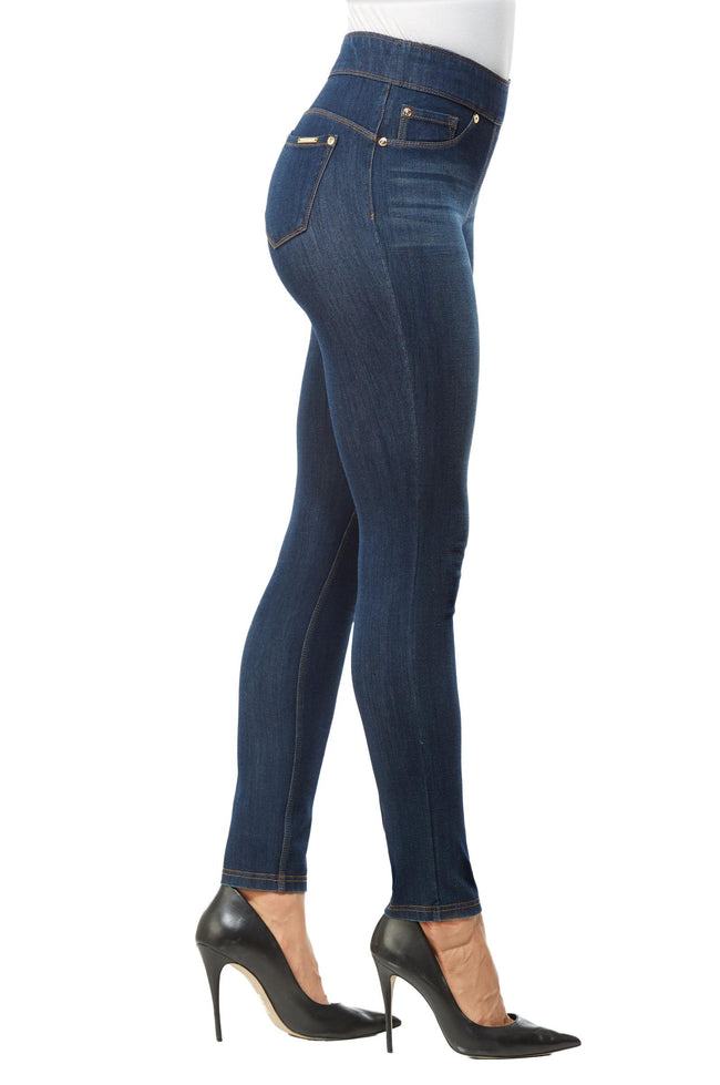 Side view woman wearing dark indigo wash jeggings with high heels