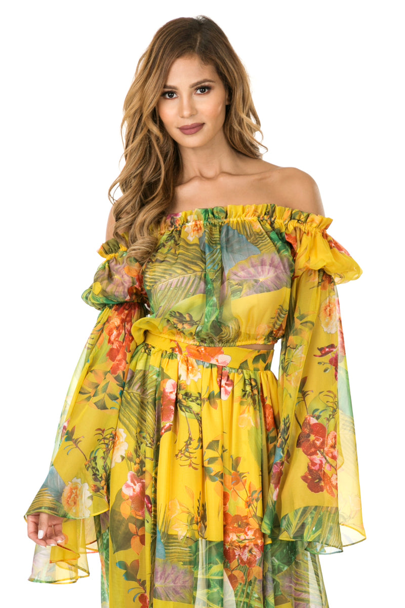 Front view woman wearing sheer yellow floral off the shoulder woven crop top