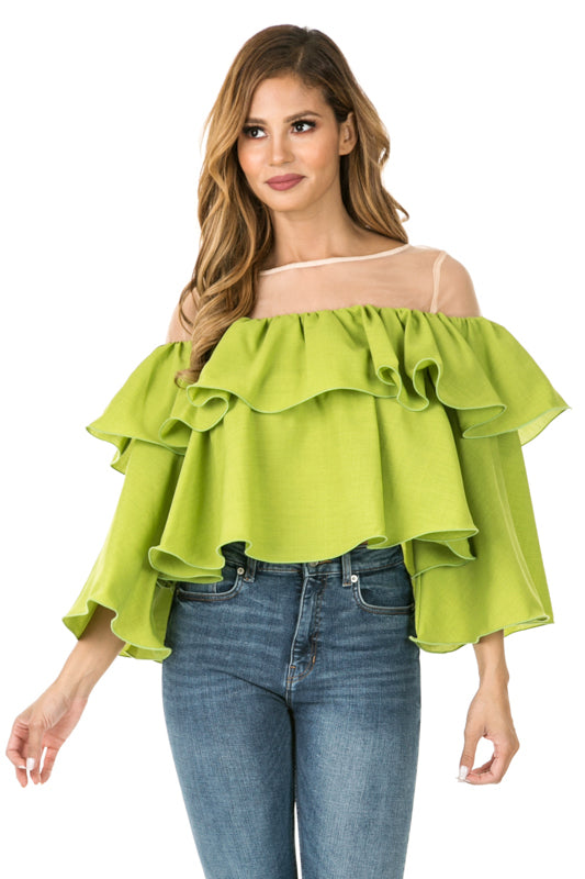Front view woman wearing cactus green sheer shoulder yoke ruffled crop blouse