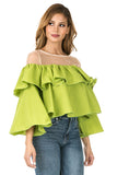 Right side view woman wearing cactus green sheer shoulder yoke ruffled crop blouse