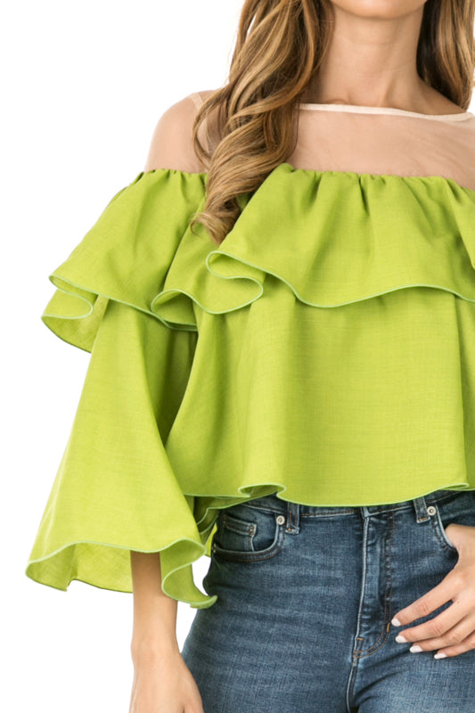 Front detail view woman wearing cactus green sheer shoulder yoke ruffled crop blouse