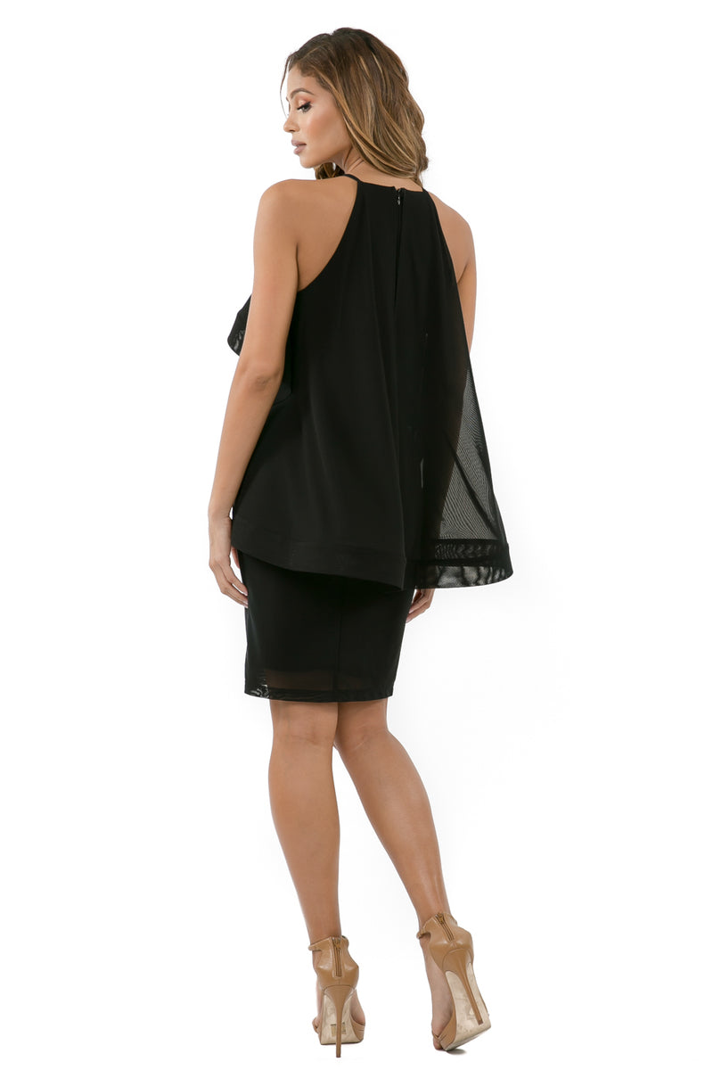 Full back view woman wearing black halter dress with layered high-low cape
