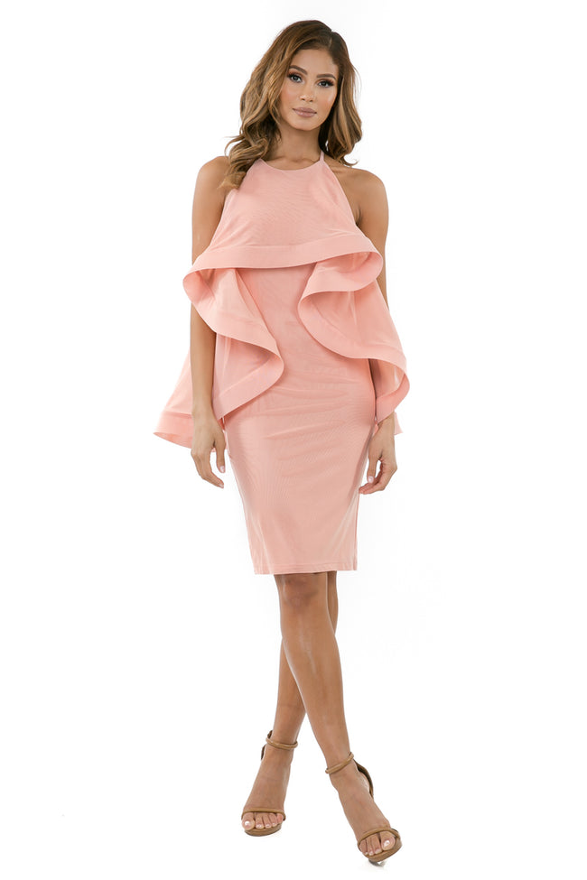 Front full view woman wearing light pink halter dress with layered high-low cape