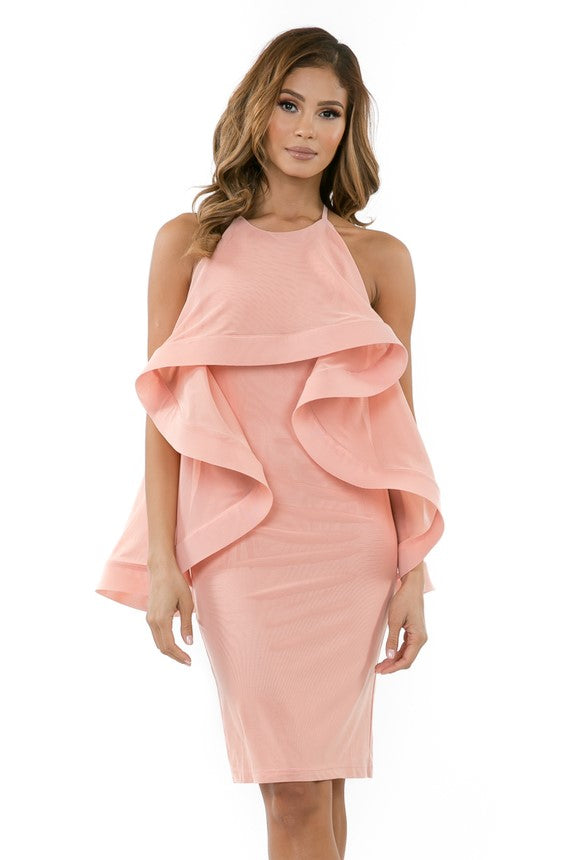 Front view woman wearing light pink halter dress with layered high-low cape