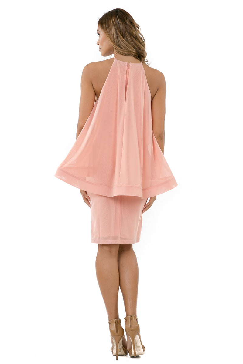 Back full view woman wearing light pink halter dress with layered high-low cape