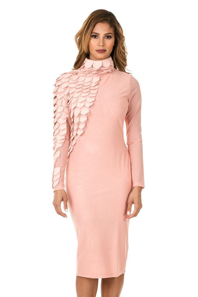 Front view woman wearing light pink midi dress with layered patches from neck to right wrist