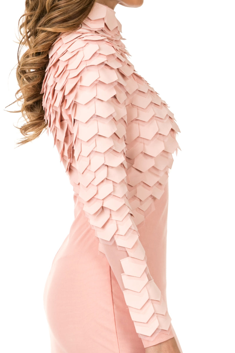 Side detail view light pink midi dress with layered patches from neck to right wrist