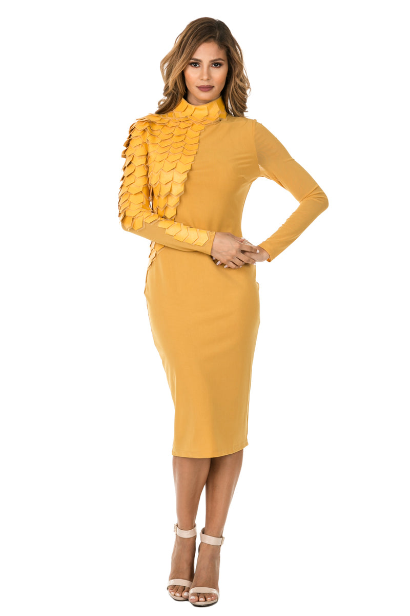 Front full view woman wearing mustard-colored midi dress with layered patches from neck to wrist