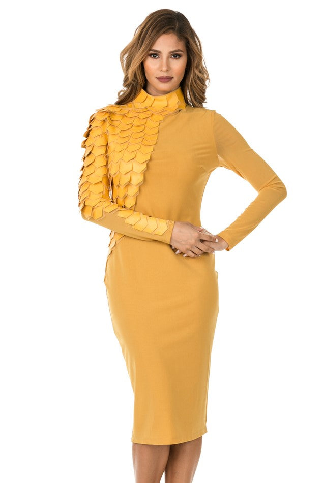 Front view woman wearing mustard-colored midi dress with layered patches from neck to right wrist