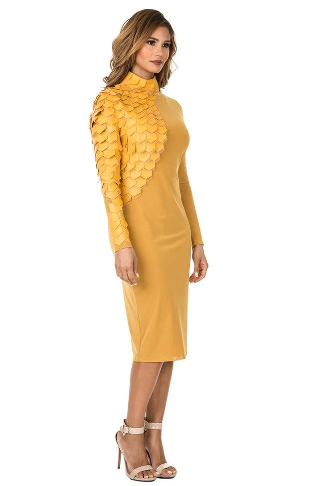 Right view woman wearing mustard-colored midi dress with layered patches from neck to wrist