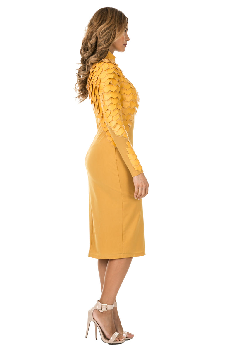 Side full view woman wearing mustard-colored midi dress with layered patches from neck to wrist