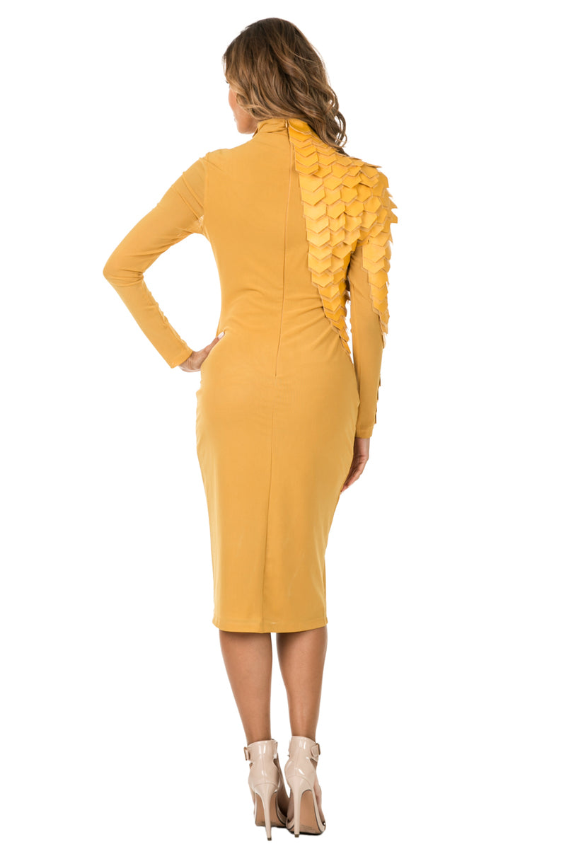Back full view woman wearing mustard-colored midi dress with layered patches from neck to wrist