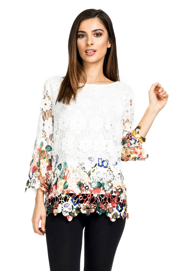 Front view woman wearing white crochet overlay top with floral print border