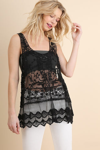 Front view woman wearing black sheer lace tank top with crochet trim