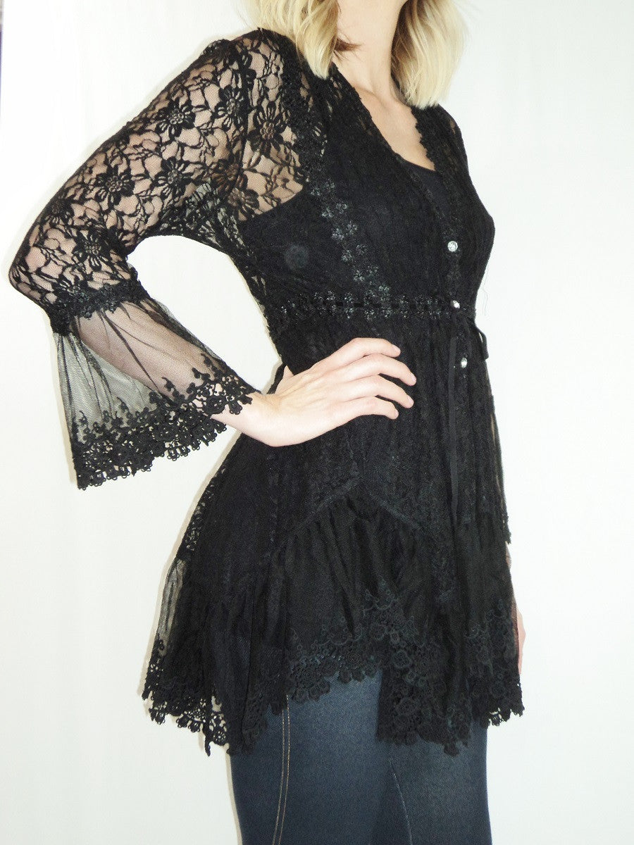 Side view woman wearing black empire waist stretch lace bell sleeve tunic top