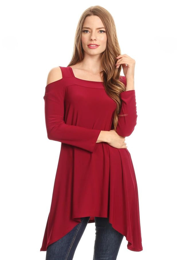 Front view woman wearing burgundy cold shoulder knit tunic top with shark bite hem