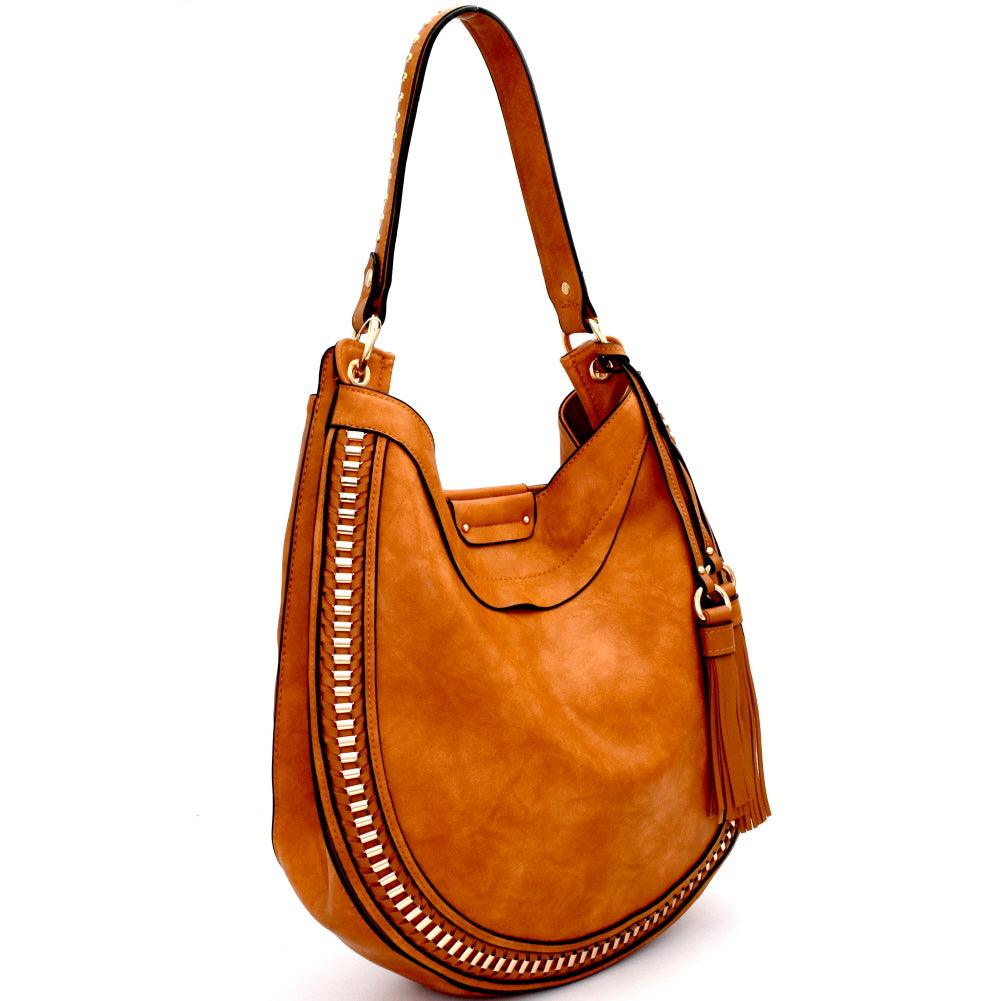 Right side view tan rounded hobo handbag with two tassels on left side