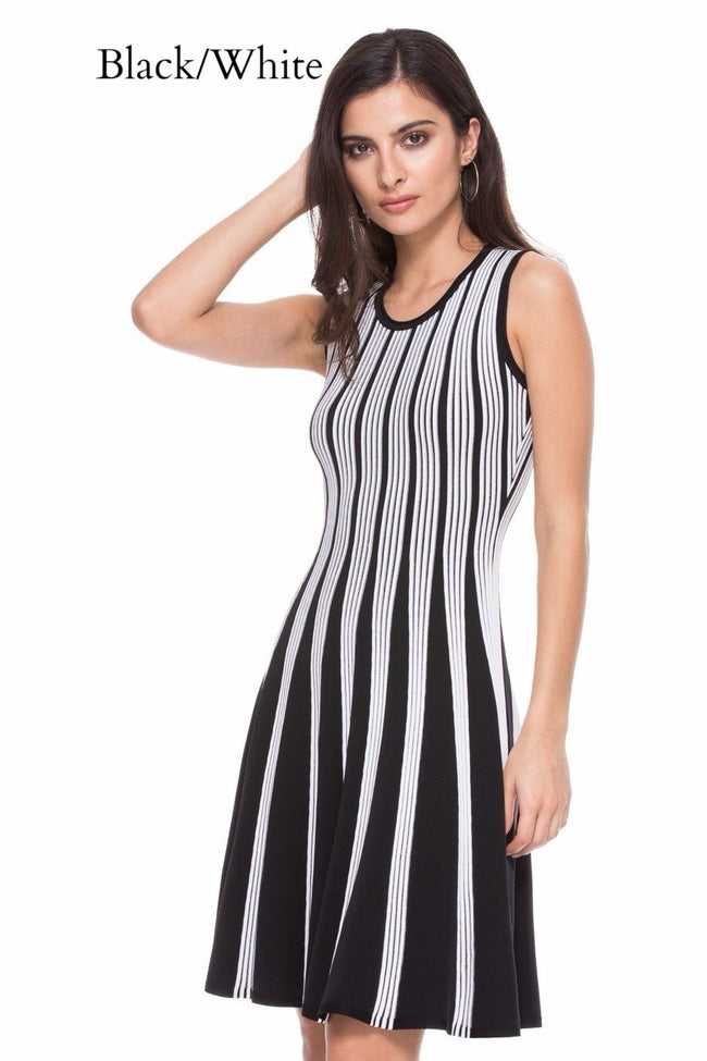 Front view woman wearing black/white striped knit sleeveless fit-and-flare knee-length dress