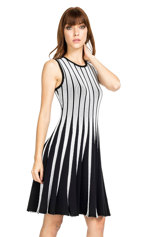 Woman wearing black/white striped knit sleeveless fit-and-flare knee-length dress