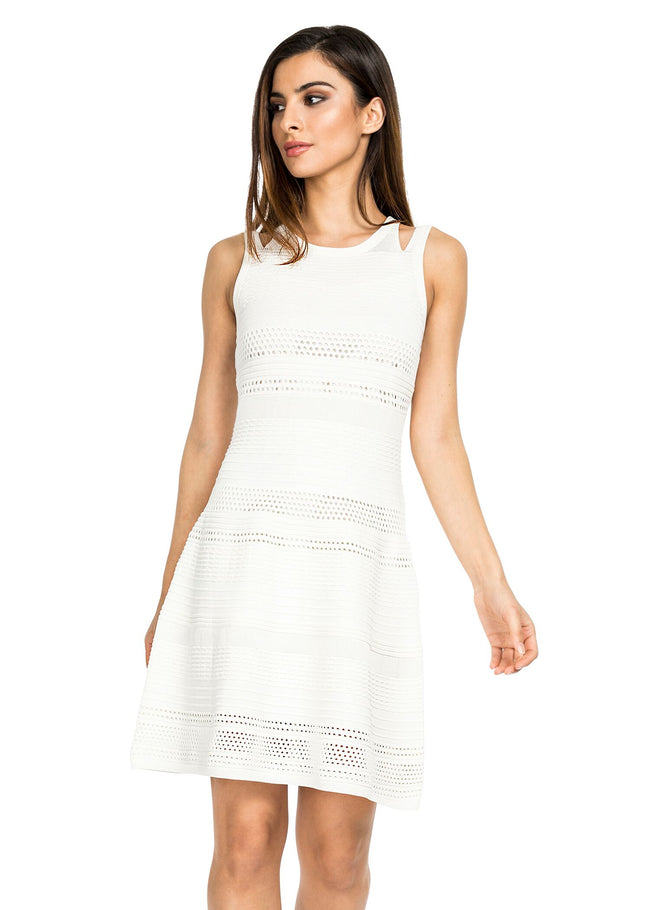Front view woman wearing white knit fit and flare dress