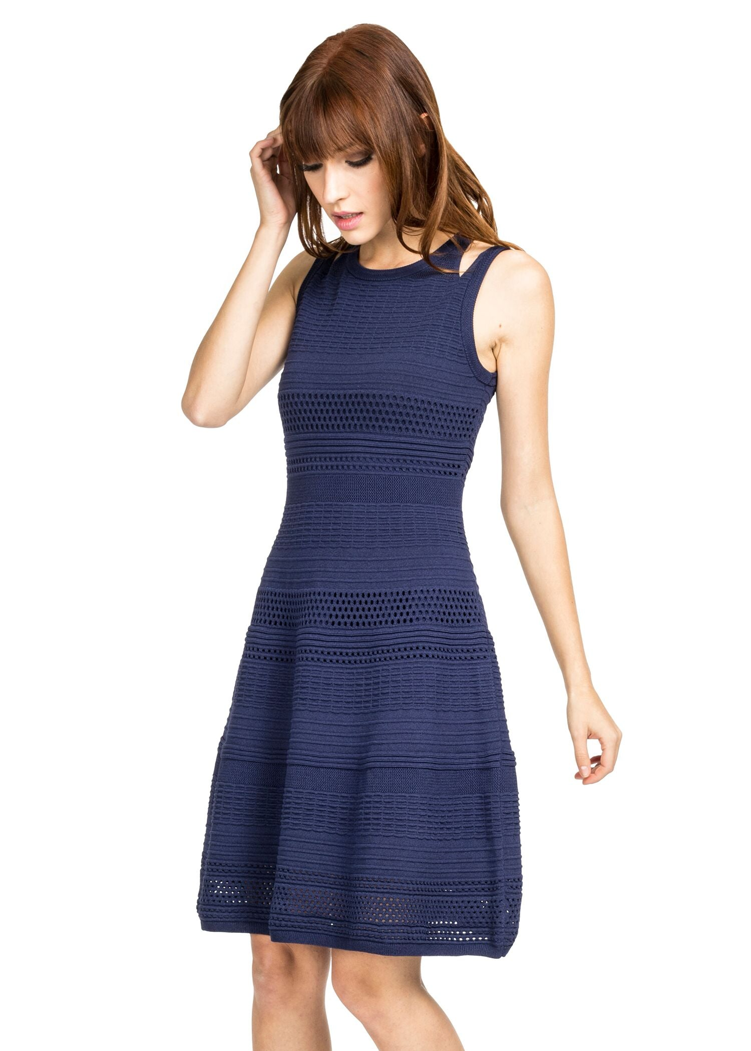 Front view woman wearing navy knit fit and flare dress