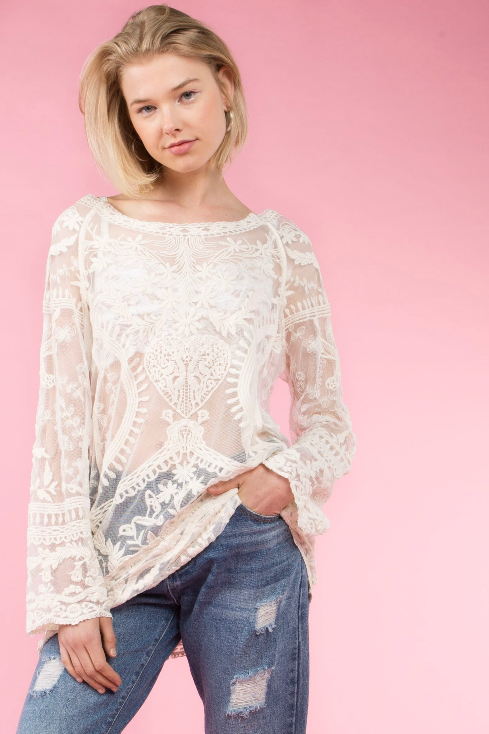 Front view young woman wearing natural colored lace tunic top with wide boat neckline