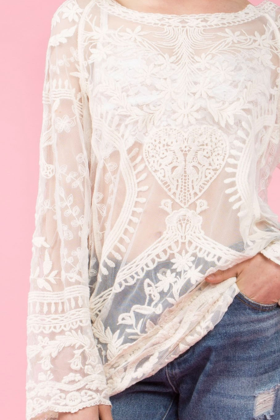 Detail view natural colored lace tunic top with wide boat neckline