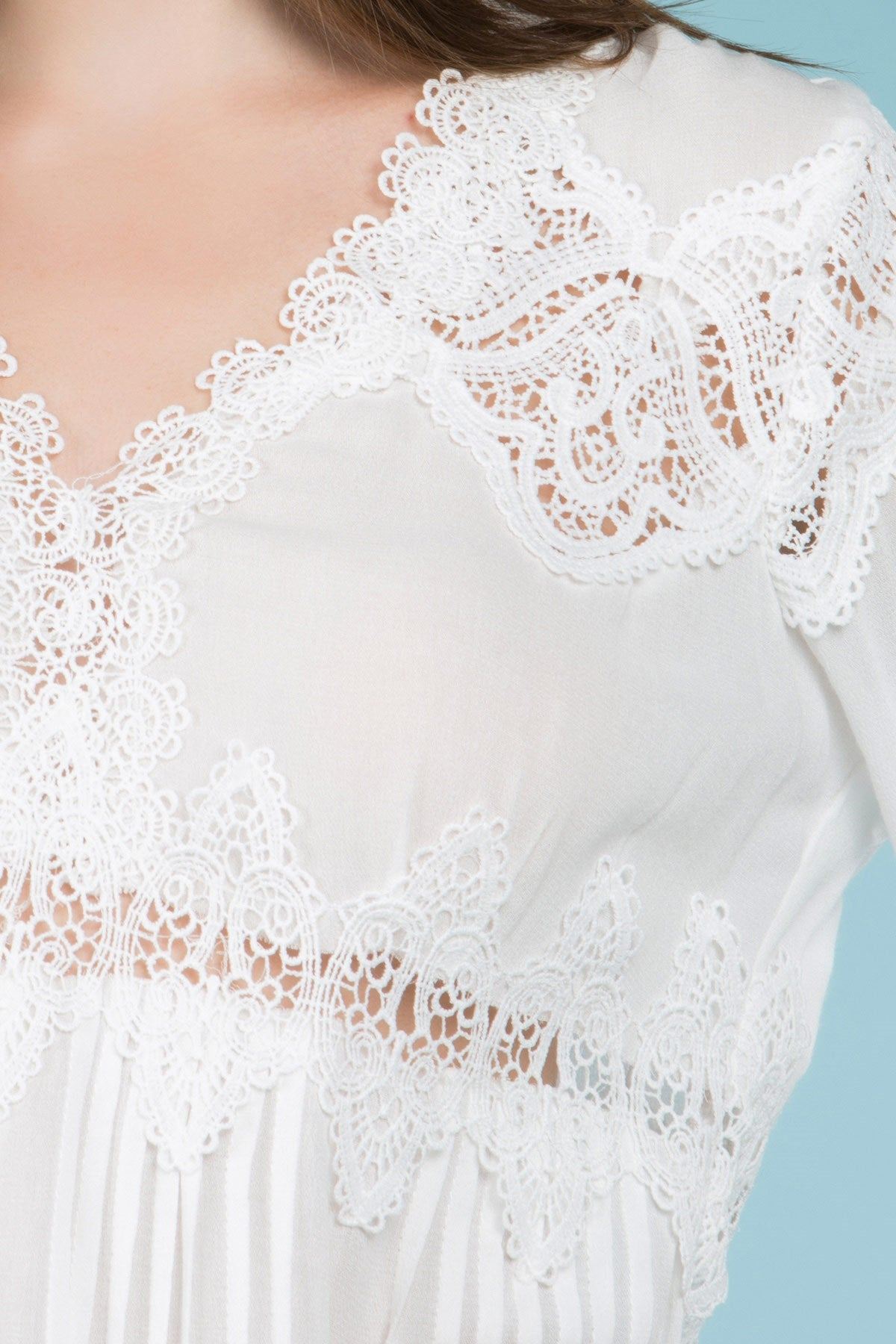 Detail view white empire waist lace trim tunic top