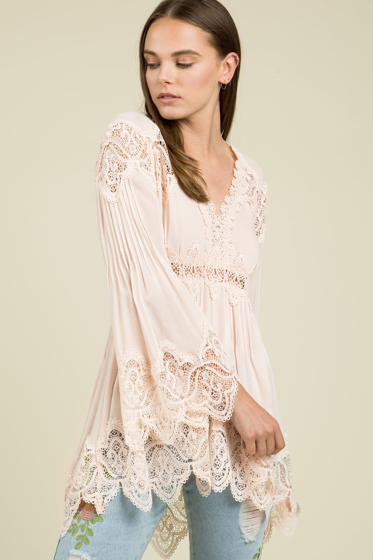 Front view young woman wearing pink empire waist lace trim tunic top - 2