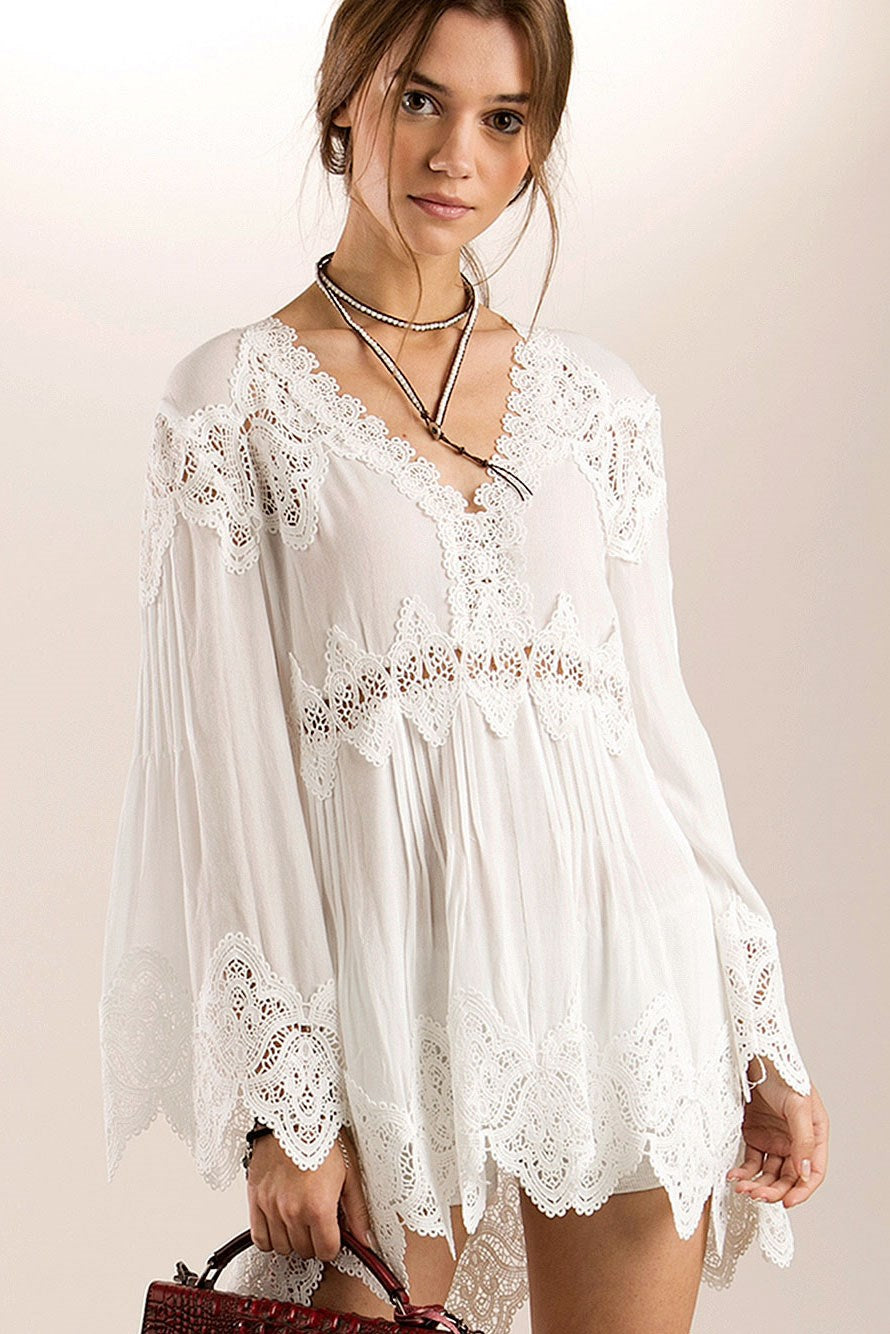 Front view young woman wearing white empire waist lace trim high-low tunic top