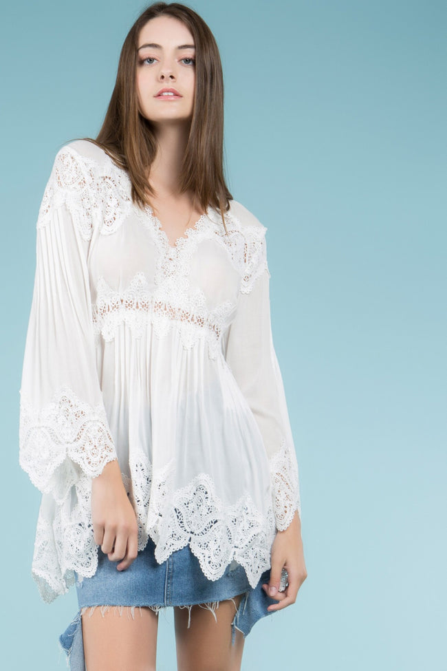 Front view young woman wearing white empire waist lace trim tunic top