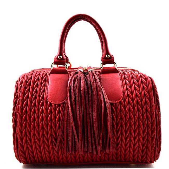 Front view red quilted satchel handbag with two long tassel accents
