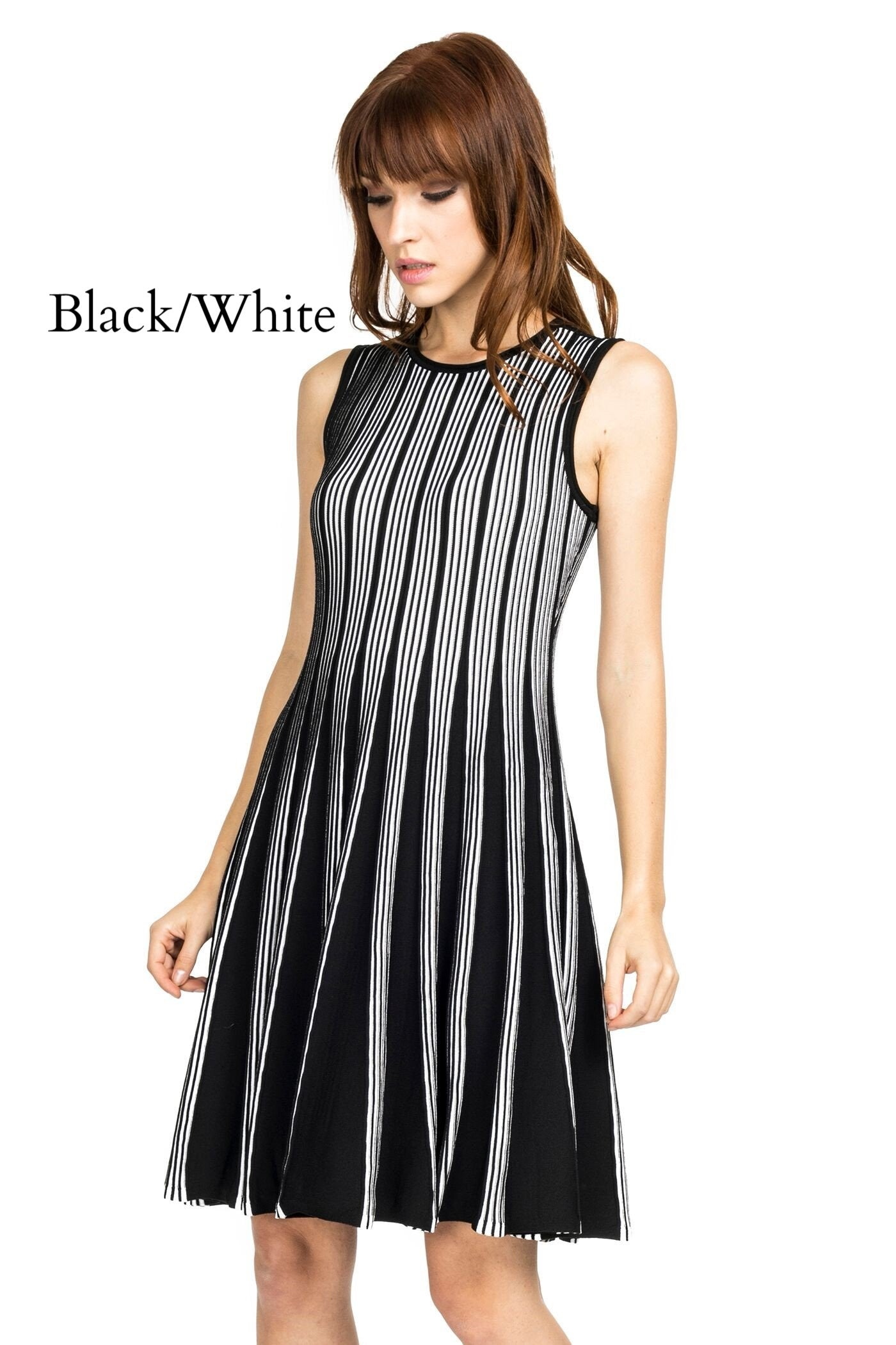 Brunette woman wearing black/white striped knit sleeveless fit-and-flare knee-length dress