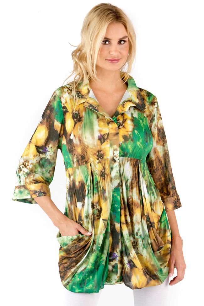Front view woman wearing green print side drape empire waist tunic top