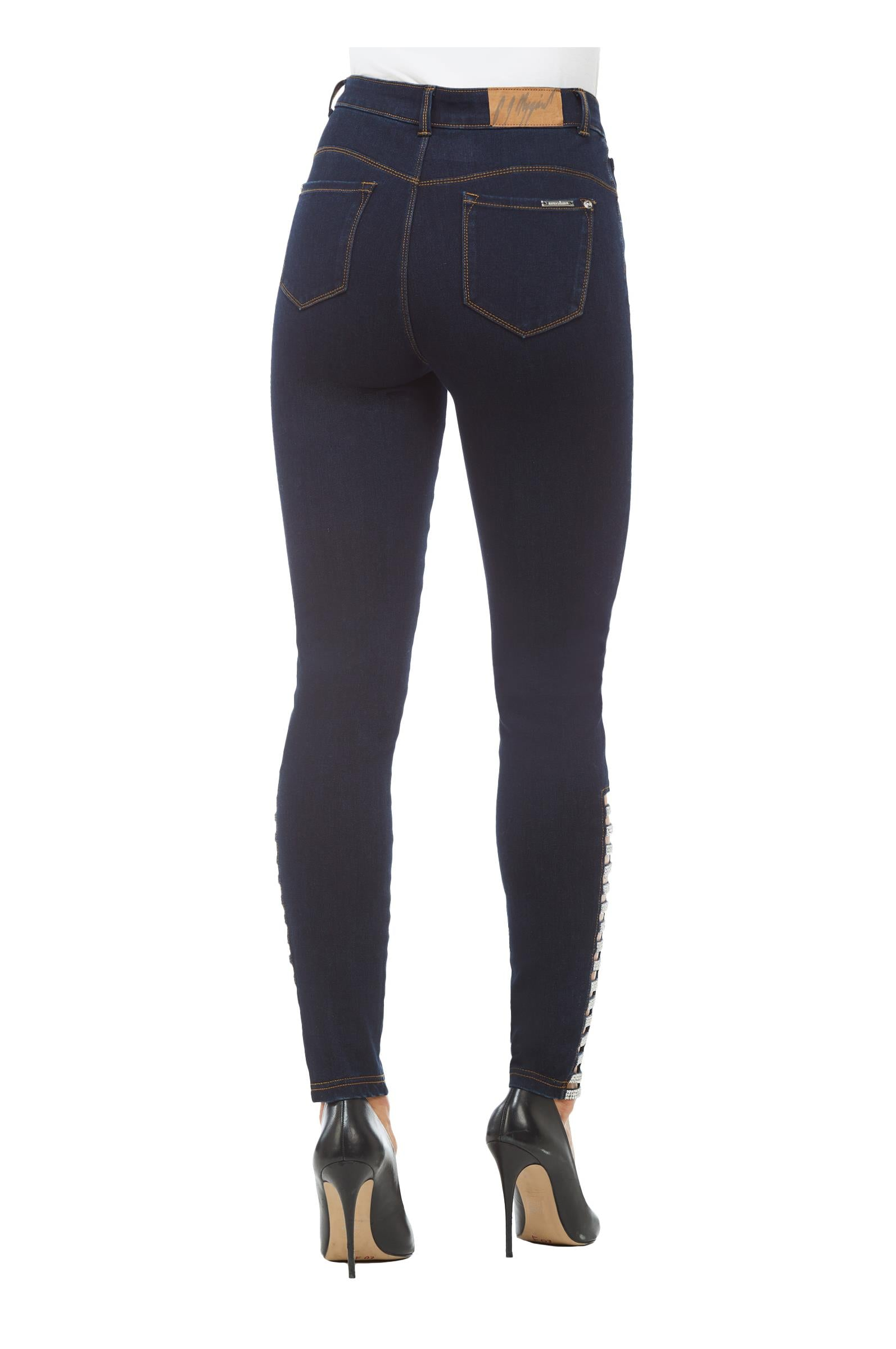 Back view woman wearing Peter Nygard denim skinny jeans with side rhinestone ladder at hemline