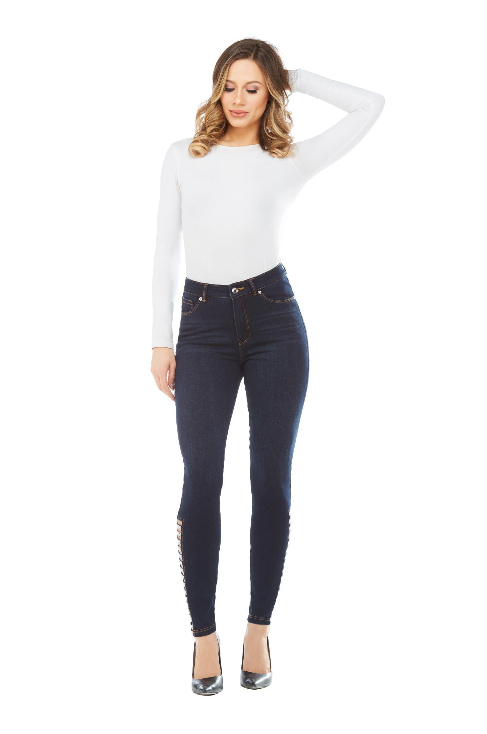 Full view woman wearing Peter Nygard denim skinny jeans with side rhinestone ladder at hemline