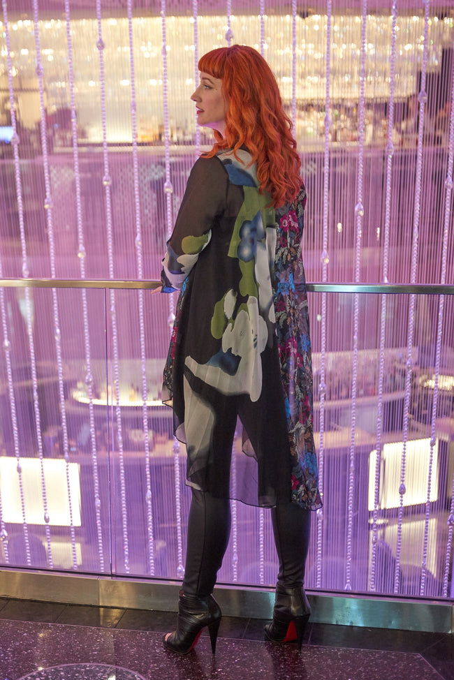 Back view woman  wearing black multi mixed print high low tunic top