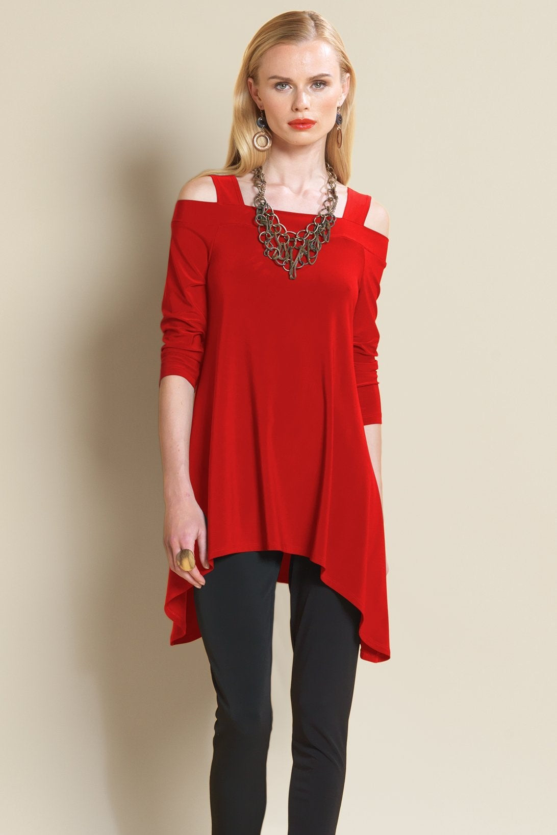 Front view woman wearing red cold shoulder tunic top and chunky necklace