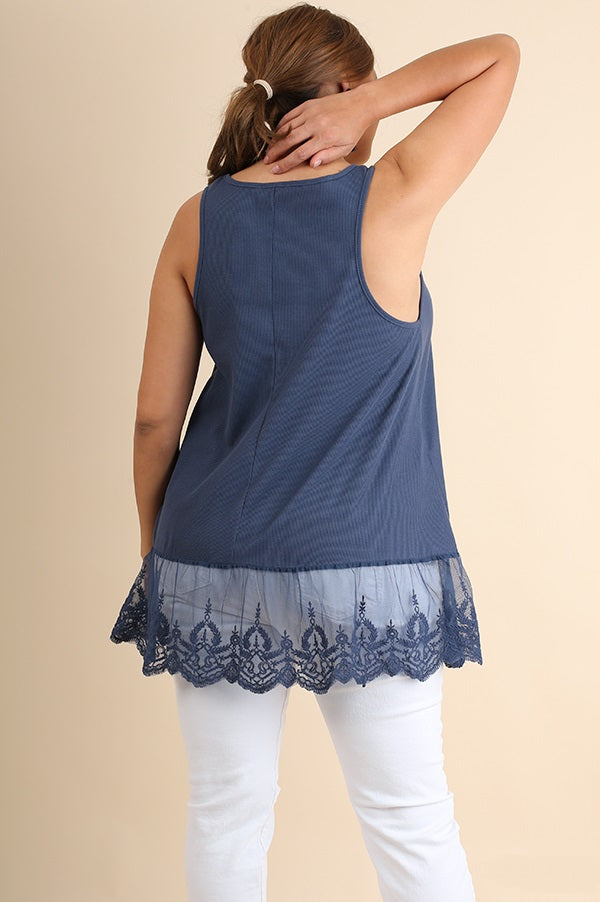 Back view young woman wearing navy plus size tank top with lace trim