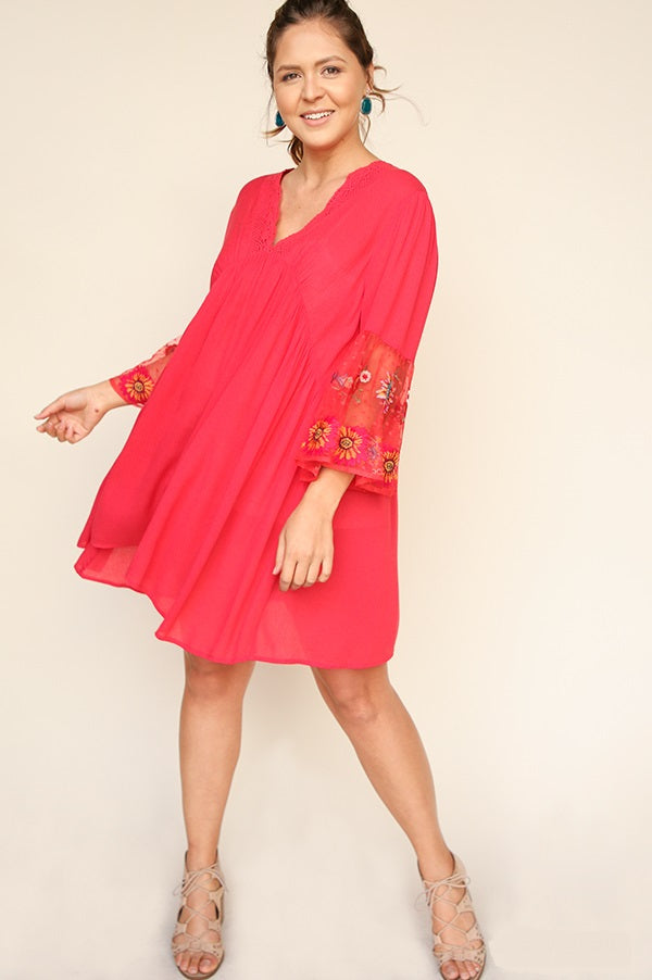 Front view young woman wearing strawberry empire waist sheer sleeve dress