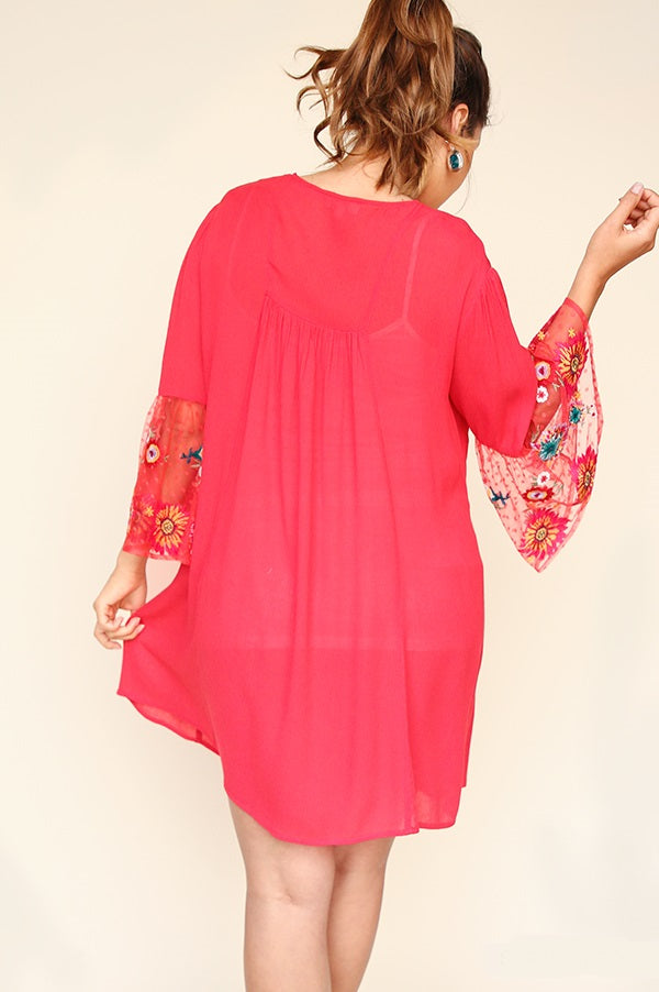 Back view young woman wearing strawberry empire waist sheer sleeve dress