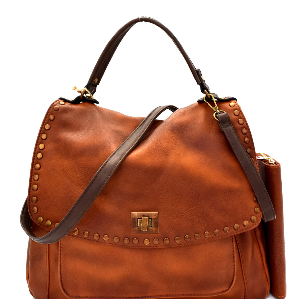 Front view brown vegan leather foldover flap satchel with stud trim and turn lock closure