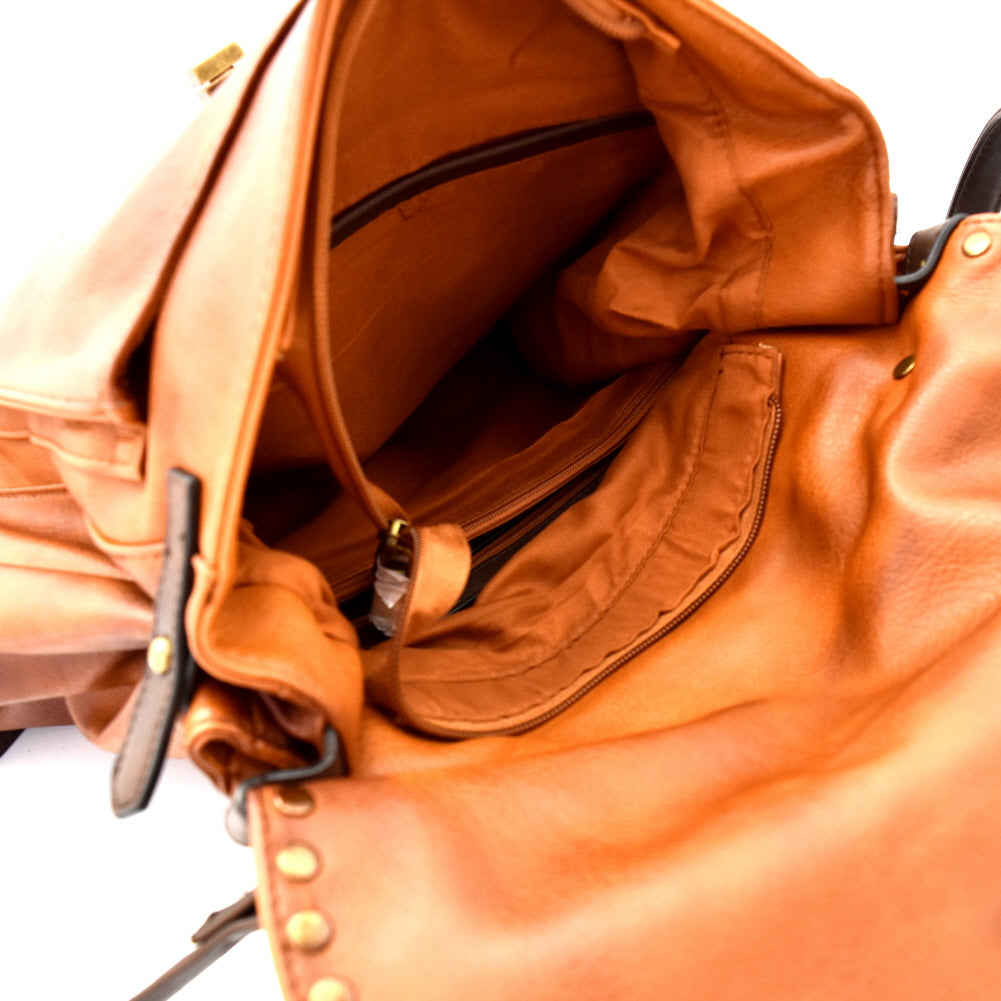 Inside view brown vegan leather foldover flap satchel with stud trim and turn lock closure