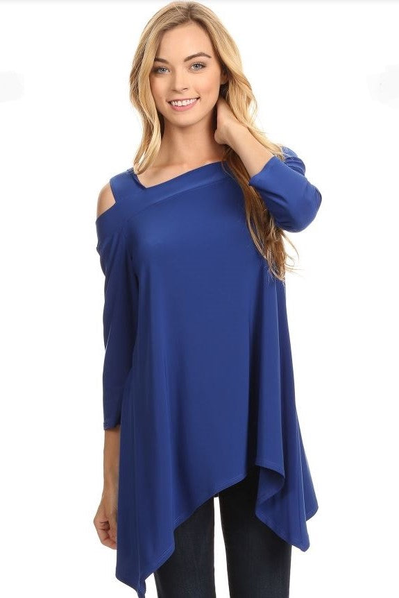 Front view woman wearing royal blue cold shoulder knit tunic top with shark bite hem