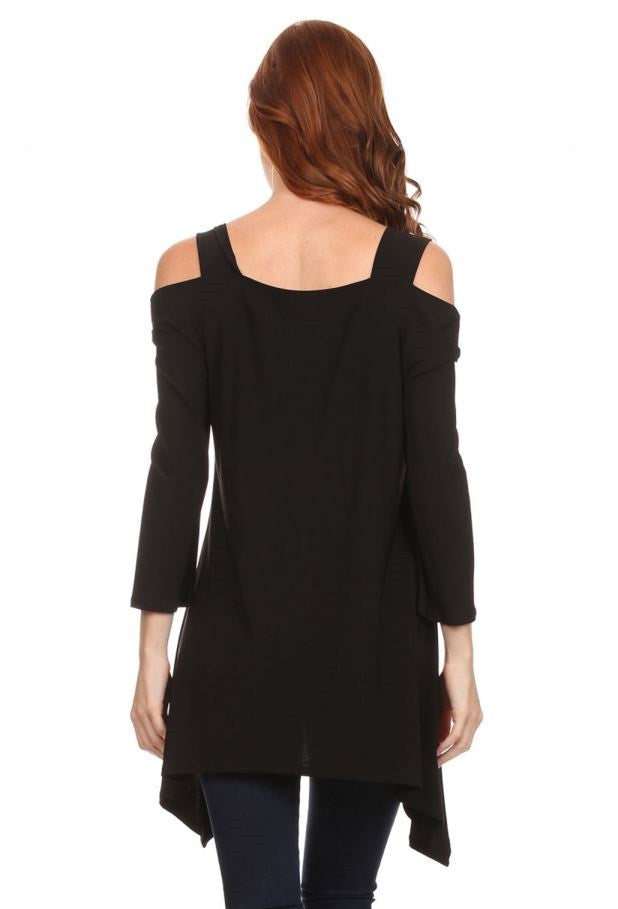 Back view woman wearing black cold shoulder knit tunic top with shark bite hem
