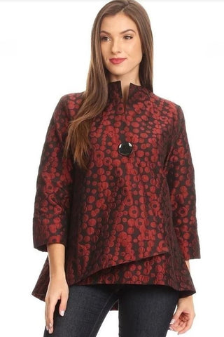 Front view plus size woman wearing asymmetrical red circle jacquard jacket with black button closure